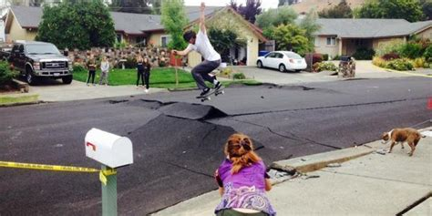 Skateboarders Turn Damaged Street Into Ramp After